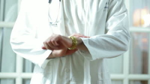 impatient-doctor-checking-his-watch